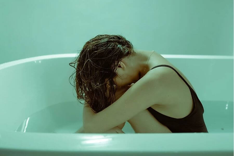 crying-woman-with-period-in-a-bathtub