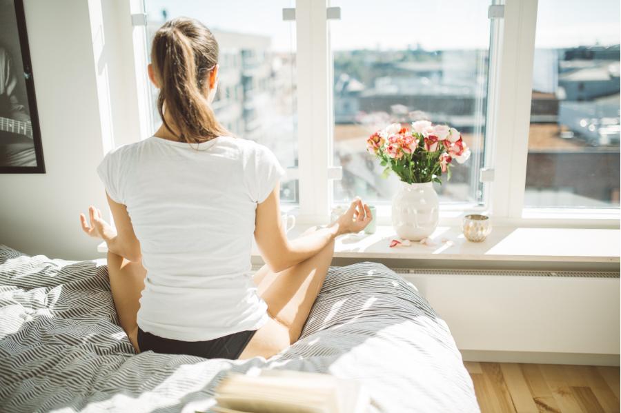 Woman in Bed Fertility Meditation